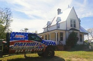 photo of Patriot truck in front of house