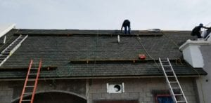 photo of Patriot Roofing worker on roof