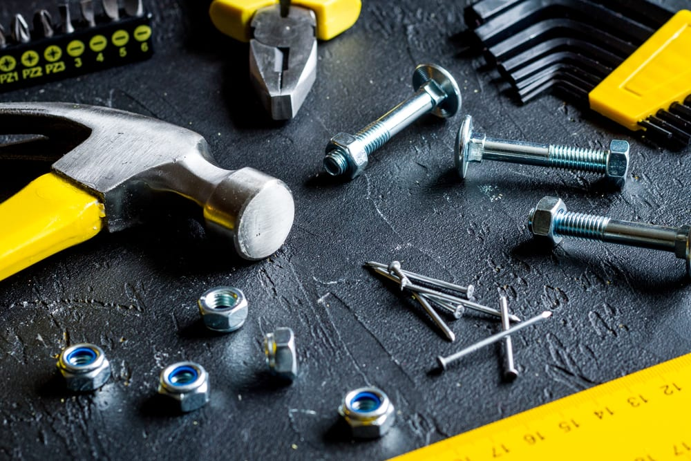photo of tools, nails and nuts and bolts