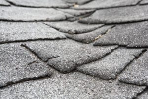 roof shingles that are cracked and curling