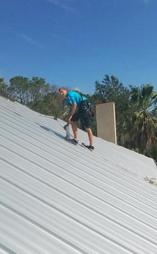 workers from Patriot Roofing installing a new roof